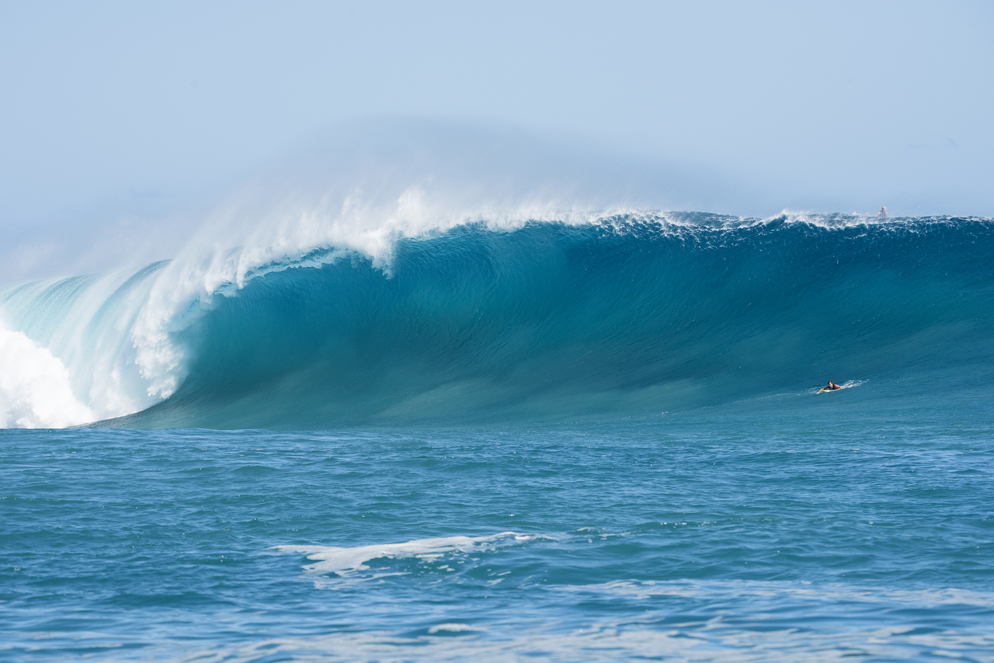 paddling into a monster at cloudbreak