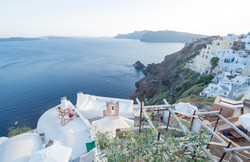 people chilling on a rooftop in oia