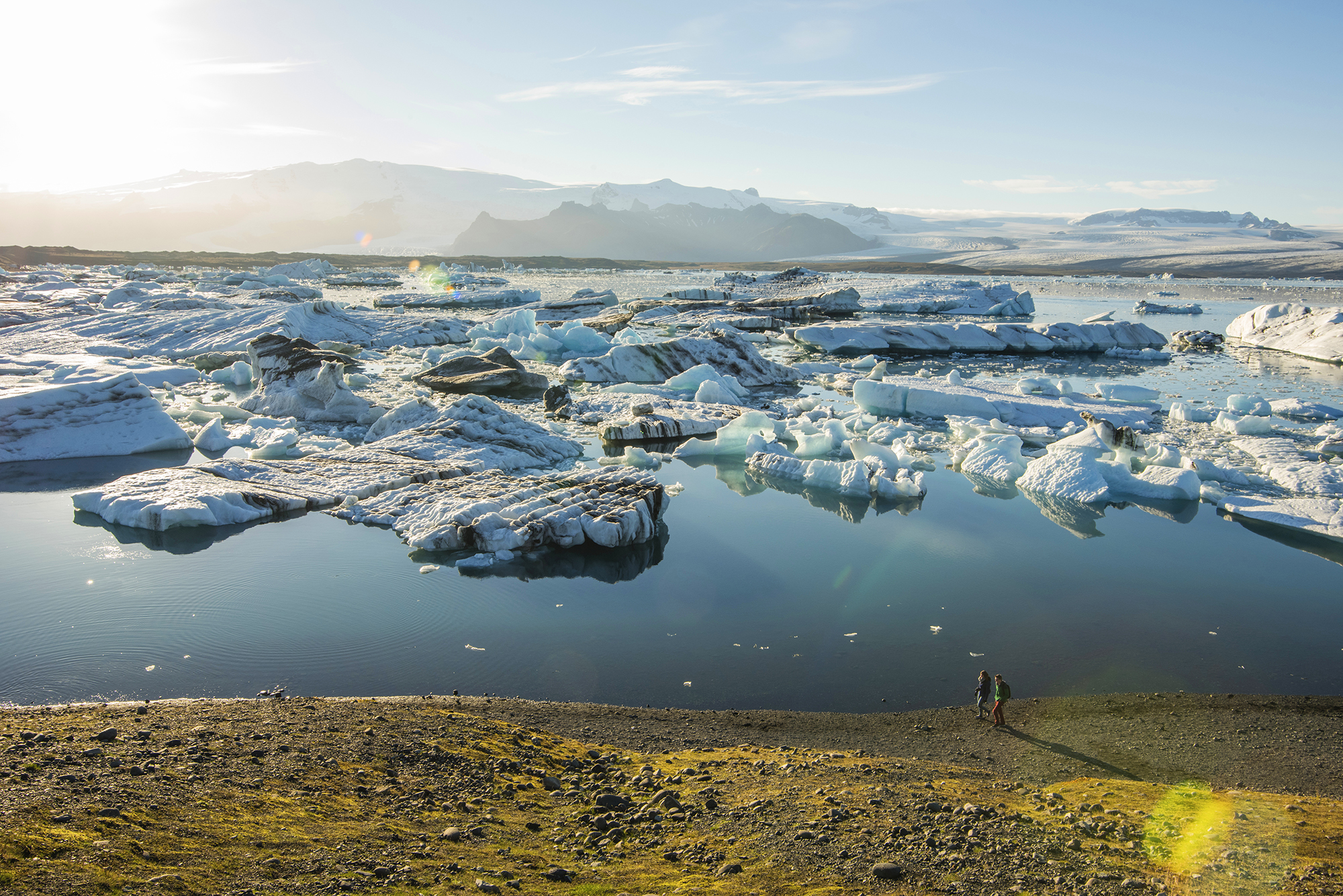 walking along jokulsarlon glacier lagoon