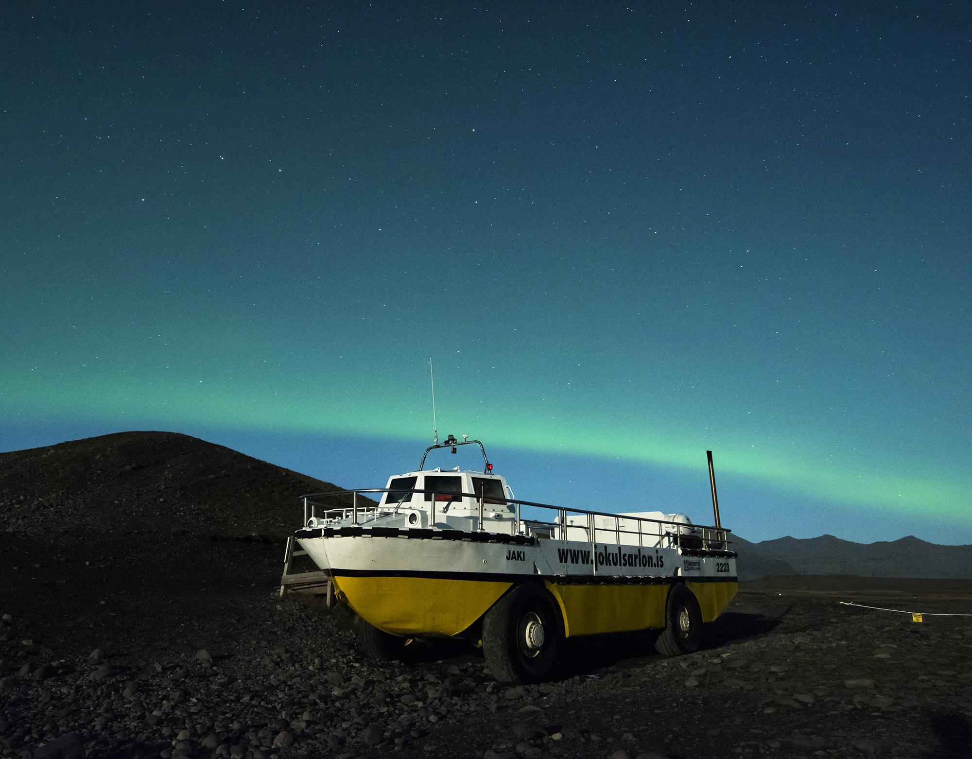 jokulsarlon glacier boat with northern lights