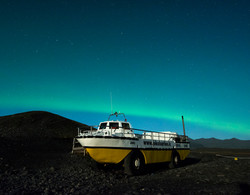 jokulsarlon glacier boat with northern lights