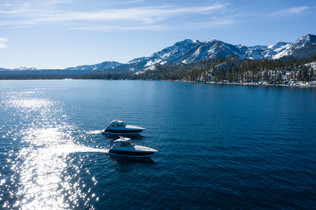 Both Boats with Mt Tallac in background.
