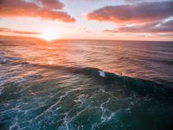 surfer log cabins sunset