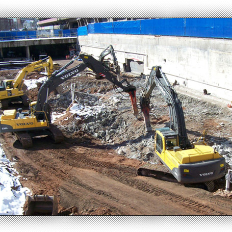 Demolition of concrete walls at Gateway College site in New Haven.