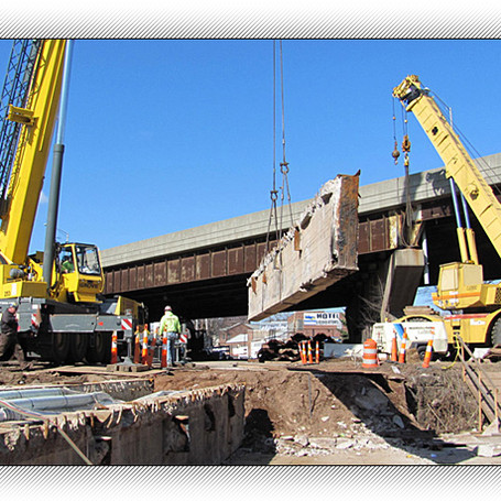 Removal of superstructure concrete beams at the State St Bridge over Mill river in New Haven for Ct.