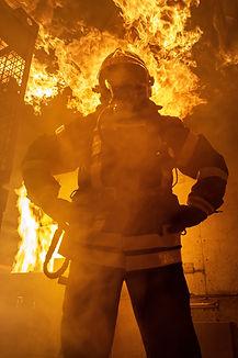 fireman-standing-near-fire-on-building-3