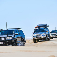 4x4 convoy driving on sand