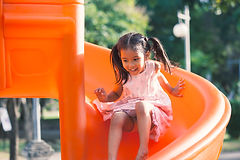 Young girl going down slide. Playground. Childcare near me. Daycare near me.