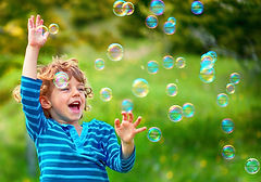 Young child kid playing with bubbles. Childcare near me. Daycare near me.