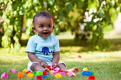 African-American toddler playing with blocks. Childcare near me. Daycare near me.