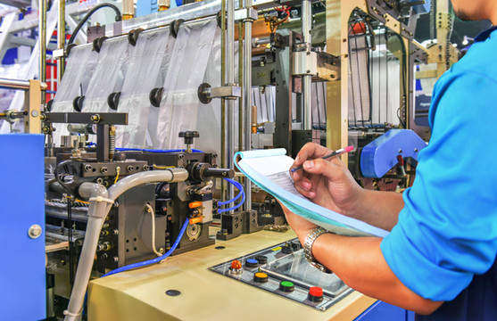 Engineer Checking Production Line