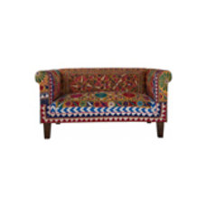 Two seater sofa covered in old embroideries