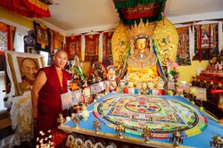 Ven. Lama Konchok Sonam stands with US Jowo & Completed Sand Mandala