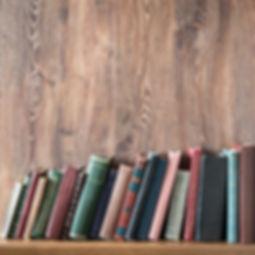 Old books on wooden shelf..jpg