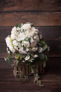 A large Unstructured White and Green Trailing Bouquet