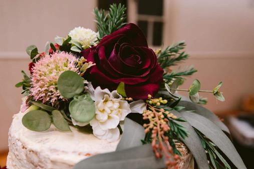 Burgundy Rose and Australian Native Cake Florals