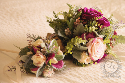 A Bridal Bouquet And Flower Girl Wand