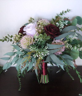 An Artificial Rustic Styled Posy Bouquet