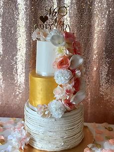 Buttercream ruffle and gold wedding cake