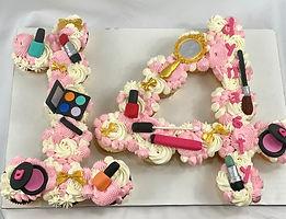 makeup themed cupcake cake