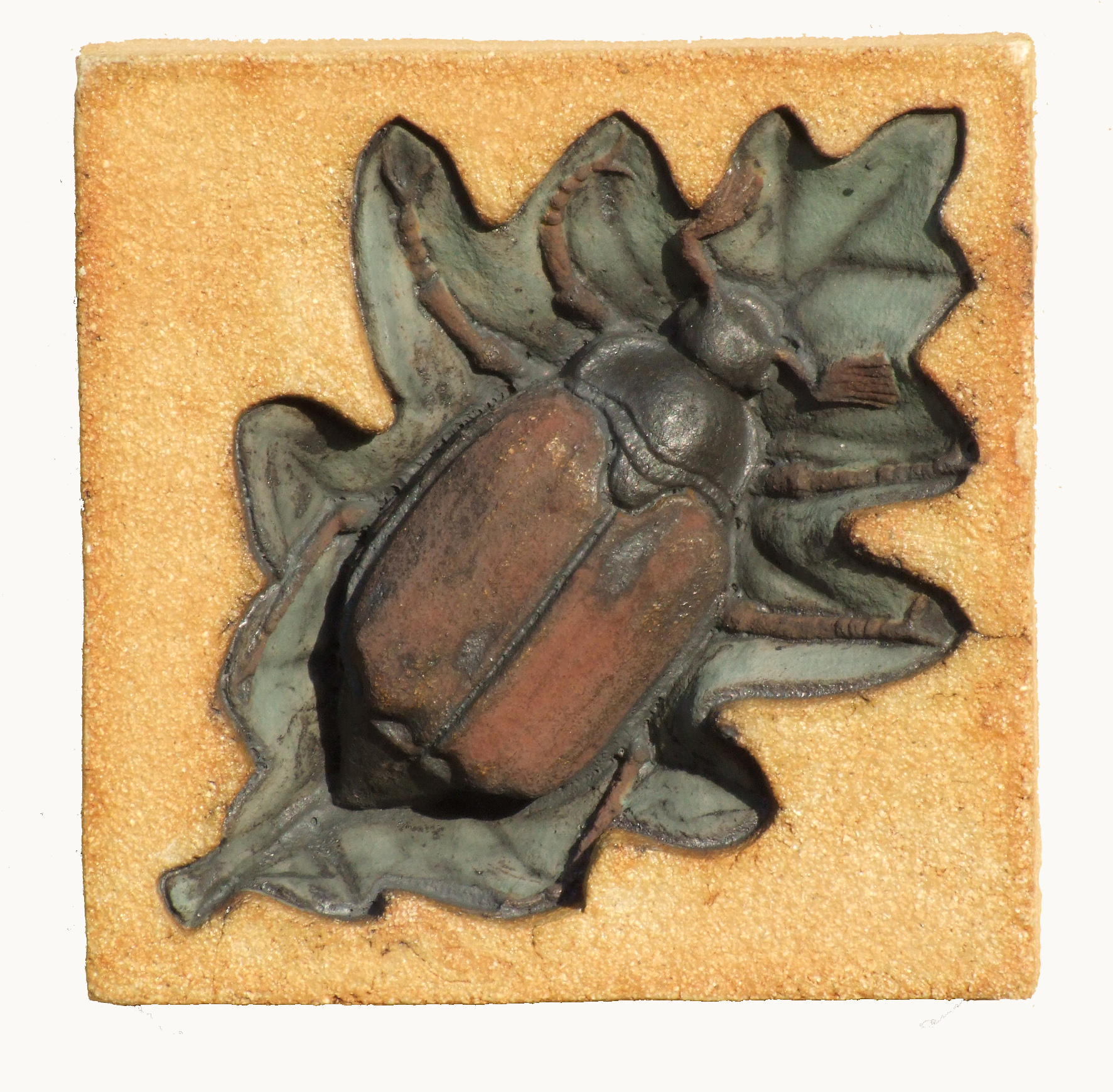 May Bug with underglaze and copper jpg