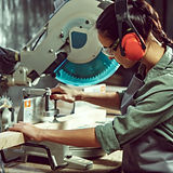 busy-and-serious-craftswoman-grinding-ti