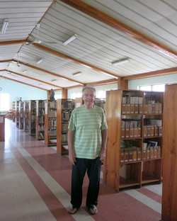 Fr Cormier in library