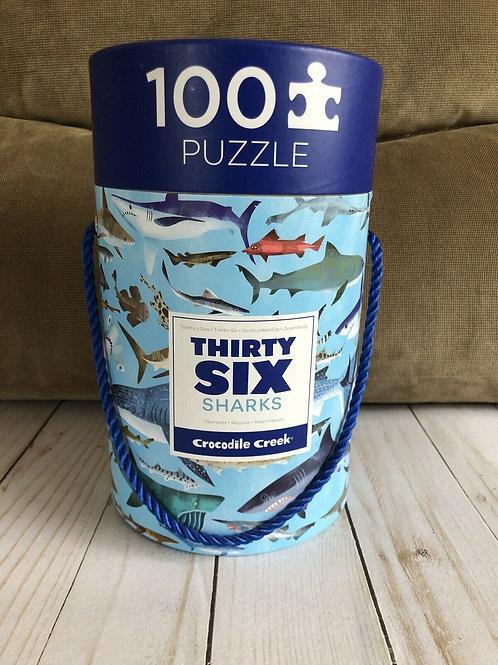 Puzzle requins en tube : 100 pièces