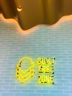 Custom neon and ceramic tile wall