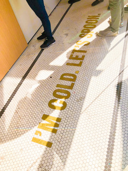 Brass letters inlaid in hex tile