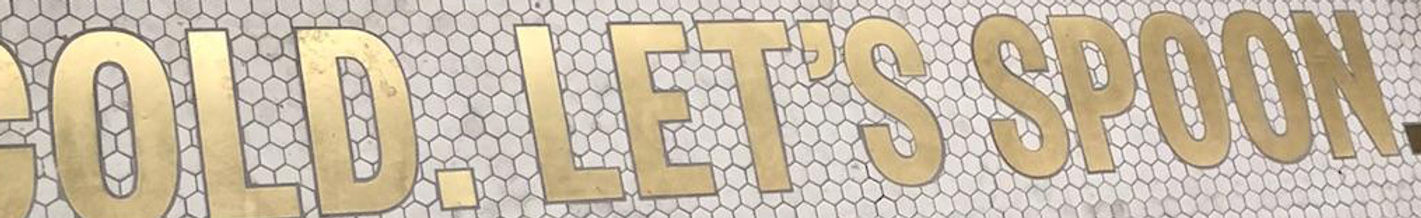 halo top branding Brass letters inlaid in ceramic hex tile