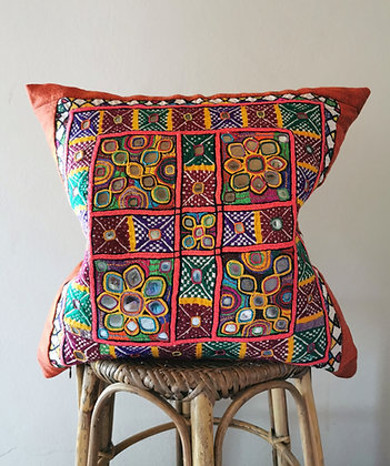 Orange embroidered pillow