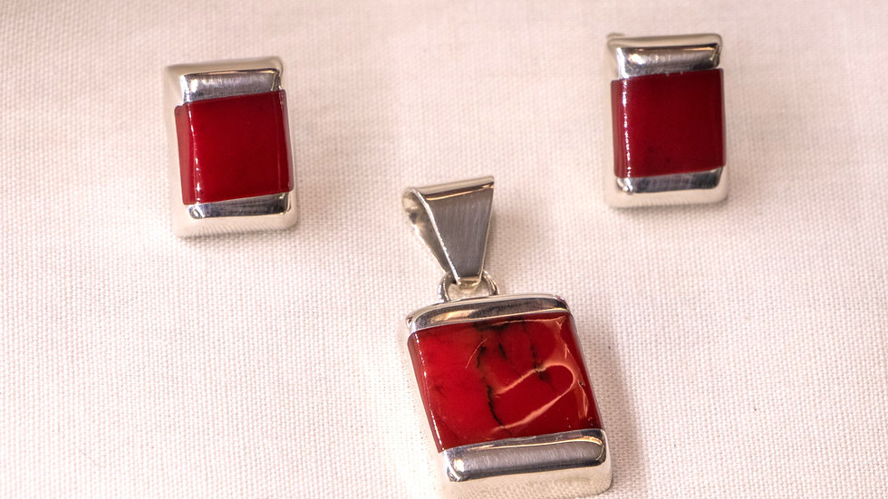 Silver earring and pendant set with red tawny coral