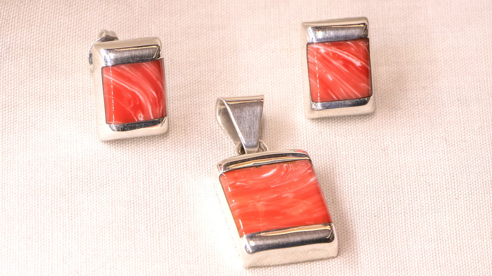 Silver earring and pendant set with orange coral stones