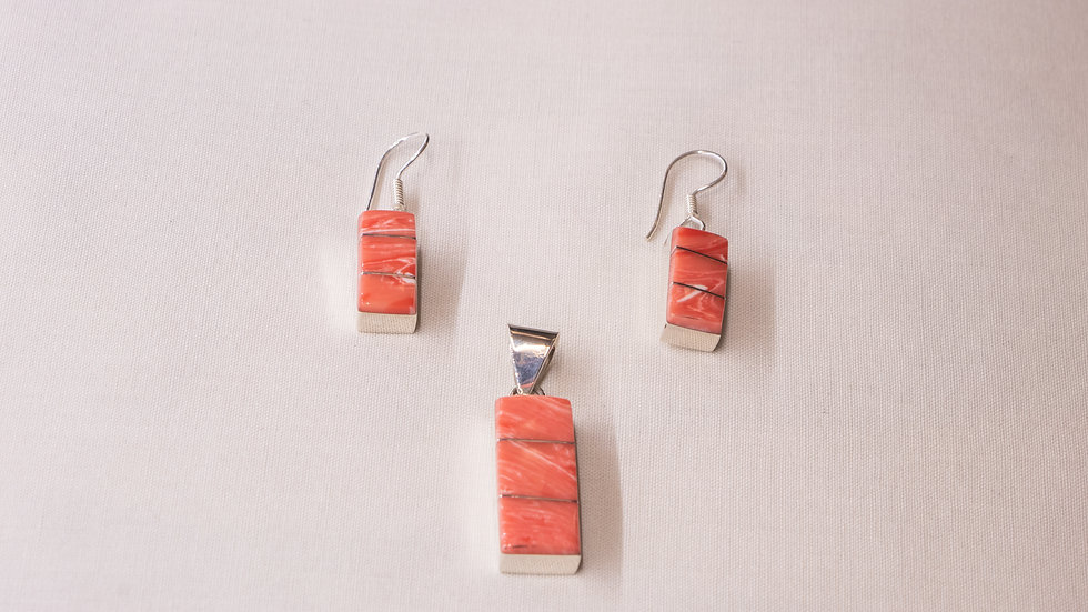 Silver earring and pendant set inlaid with coral stones