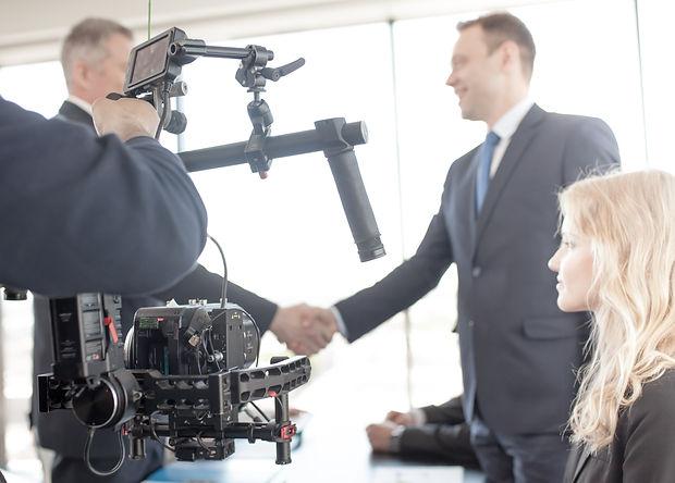 Videographer using steadycam, making vid
