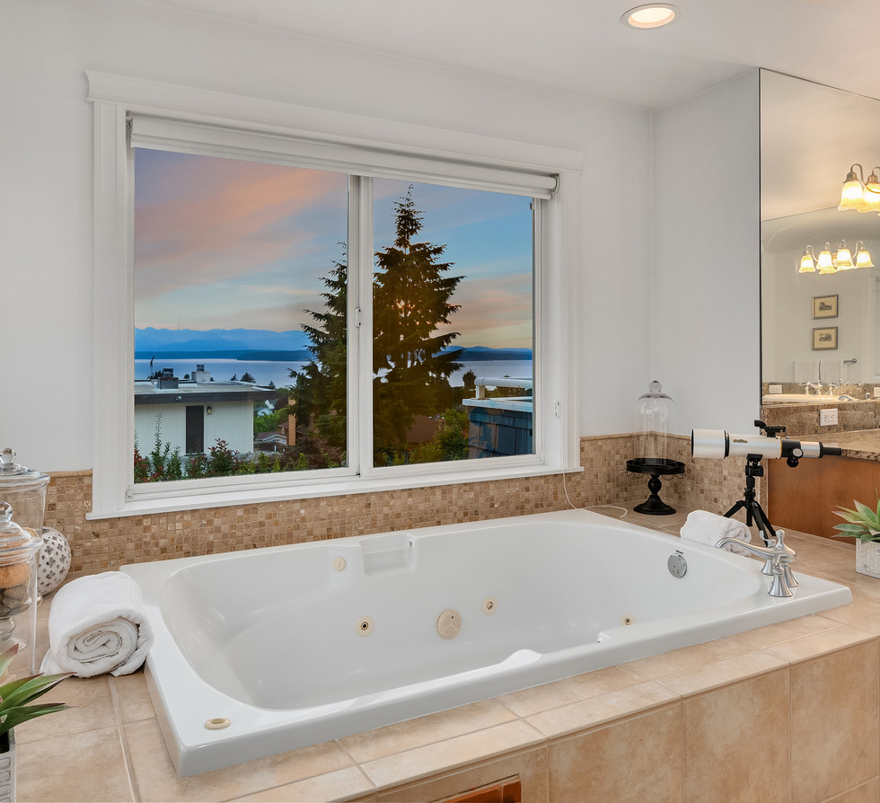 Master jetted bathtub with sunset views