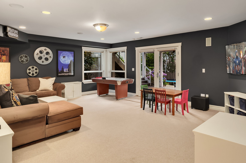 Rec room with outdoor patio and lawn