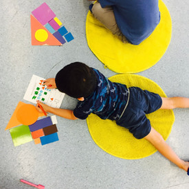 Toddlers using class materials