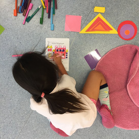Young girl in lesson drawing