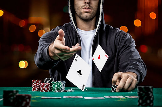 poker-player-showing-pair-aces.jpg