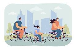 Joyful family riding bikes in city park.