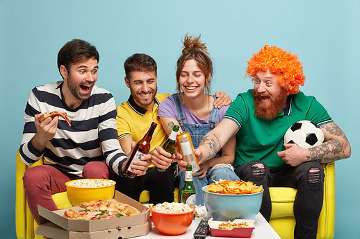 four-cheerful-friends-clink-bottles-beer