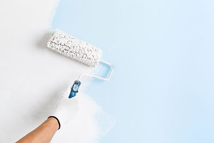 Close Up Of Painter Hand Painting A Wall.jpg