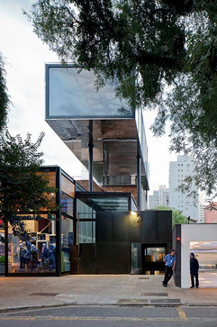 Shiny-metal-box-hovers-above-shopping-an