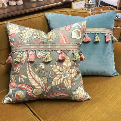 Contrast tassled pillows
