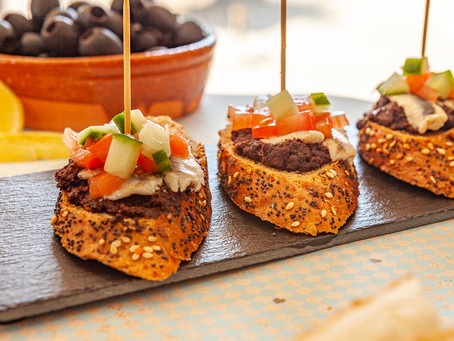 Pintxo of Black Olive Tapenade and Anchovy with a pickled tomatoes and cucumbers