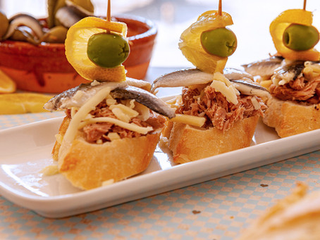 Pintxo of Anchovies and Tuna, shredded cheese and olive