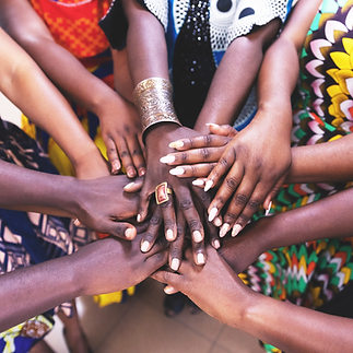 Black women in circle of hands.png