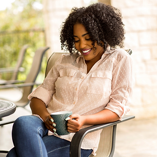 Black woman sipping tea.png